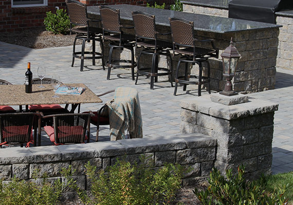 stone ledge and patio furniture