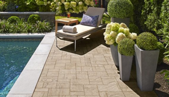 outdoor flooring beside a pool