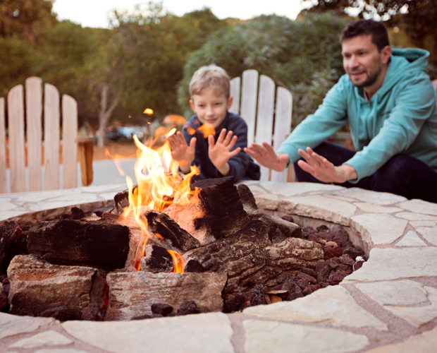 view of firepit and happy smiling family